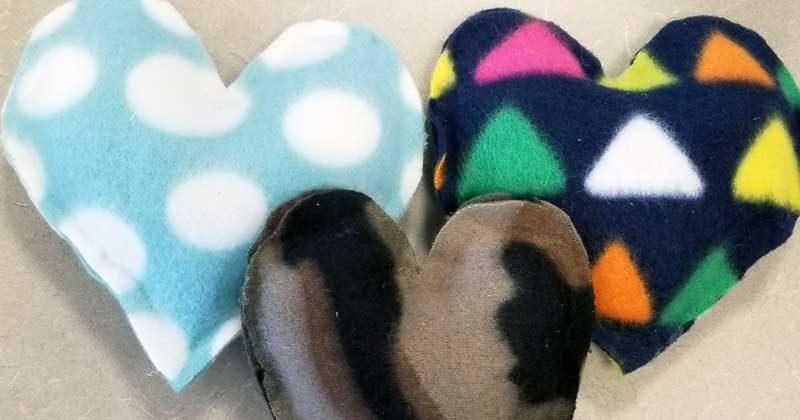 Three stuffed fleece hearts